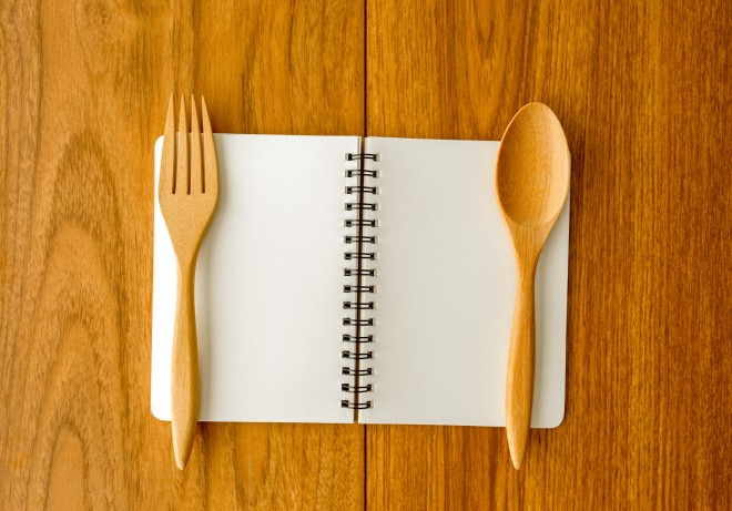 Blank notebook on plated with spoon and fork